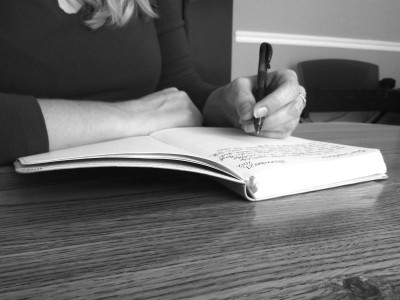 Ashley writing in notebook